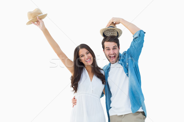 Happy hipster couple smiling at camera and cheering Stock photo © wavebreak_media