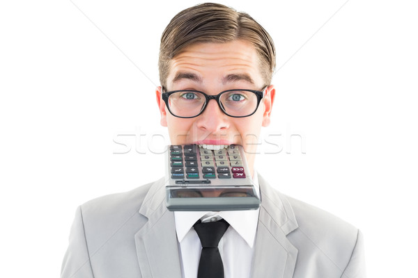 Geeky smiling businessman biting calculator Stock photo © wavebreak_media