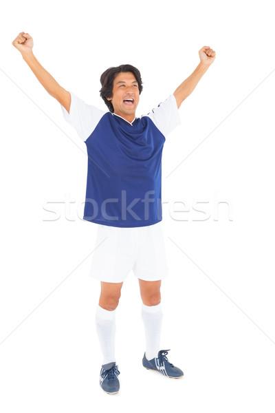 Futballista kék ünnepel fehér férfi boldog Stock fotó © wavebreak_media