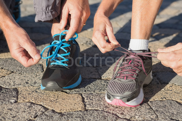 Couple tying their laces of running shoes Stock photo © wavebreak_media