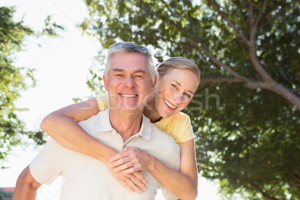 Happy senior man giving his partner a piggy back Stock photo © wavebreak_media