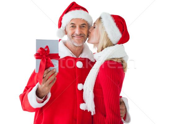 Festive couple embracing and holding gift Stock photo © wavebreak_media