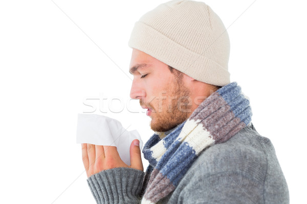 Handsome man in winter fashion blowing his nose Stock photo © wavebreak_media