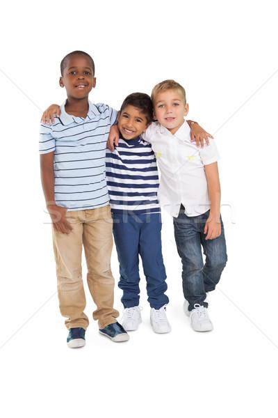 Aranyos gyerekek mosolyog kamera fehér gyermek Stock fotó © wavebreak_media