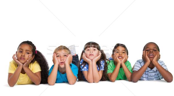 Aranyos gyerekek mosolyog kamera fehér lány Stock fotó © wavebreak_media