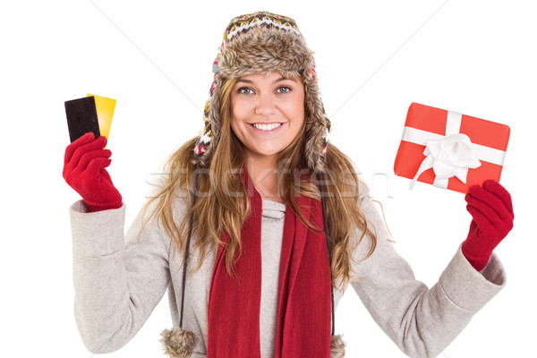 Happy blonde in winter clothes holding gifts Stock photo © wavebreak_media