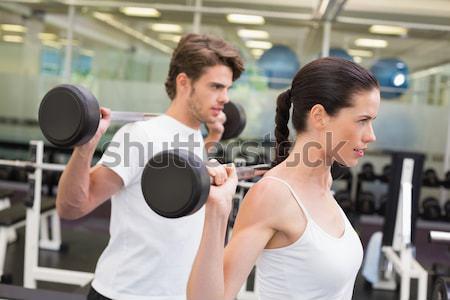 Entrenador personal ayudar cliente ascensor gimnasio Foto stock © wavebreak_media