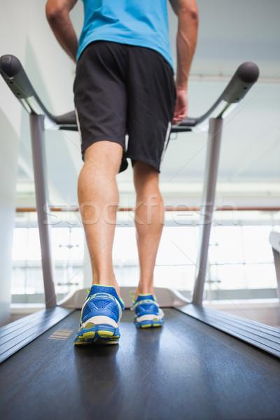 Low section of a man running on treadmill Stock photo © wavebreak_media