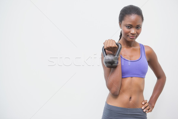 Fitt nő mosolyog kamera tart kettlebell tornaterem Stock fotó © wavebreak_media