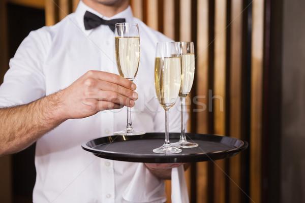 Garçom bandeja champanhe bar vidro Foto stock © wavebreak_media