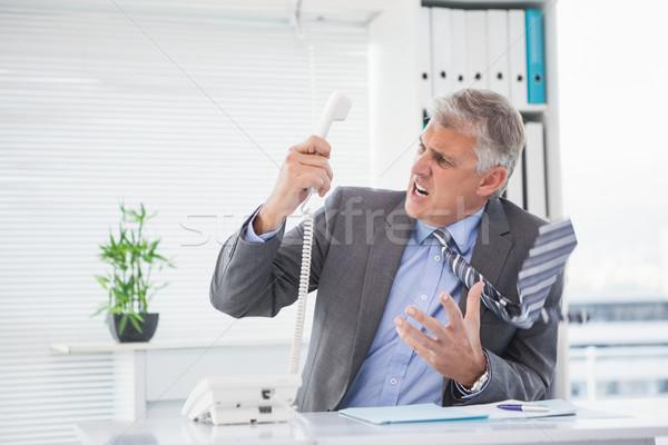 Angry businessman shouting on the phone Stock photo © wavebreak_media