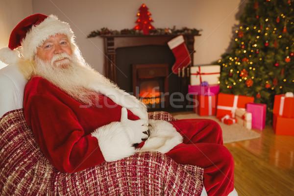 Mosolyog mikulás ül tart has otthon Stock fotó © wavebreak_media