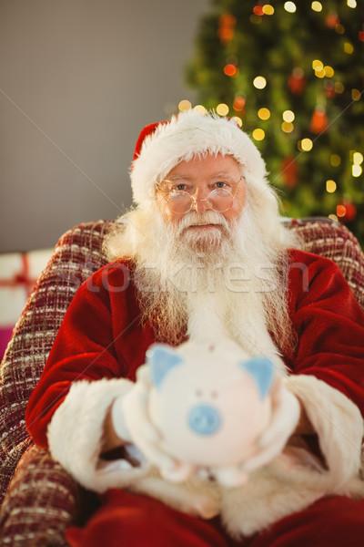Vader christmas aanbieden spaarvarken home woonkamer Stockfoto © wavebreak_media