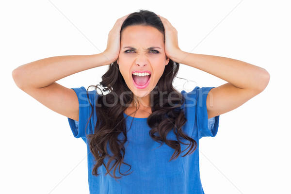 Angry brunette shouting at camera Stock photo © wavebreak_media