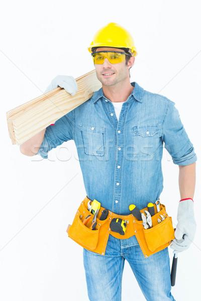 Carpenter carrying wooden planks Stock photo © wavebreak_media