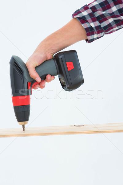 Male carpenter drilling hole in wood Stock photo © wavebreak_media