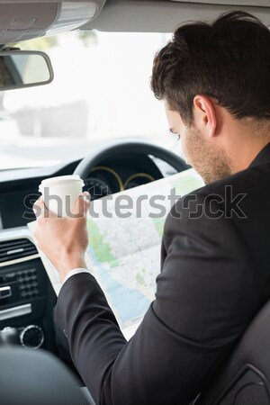 Man looking at the bumper while writing on clipboard Stock photo © wavebreak_media