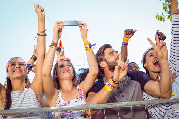 Excited music fans up the front Stock photo © wavebreak_media