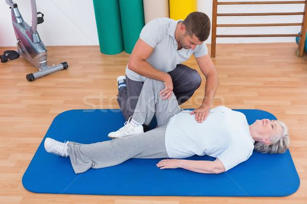 Trainer working with senior woman on exercise mat  Stock photo © wavebreak_media