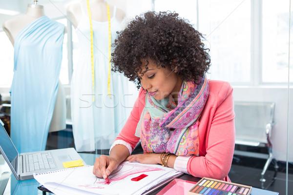 Attractive female fashion designer at work Stock photo © wavebreak_media