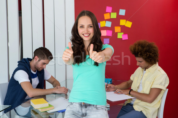 Casual young woman gesturing thumbs up Stock photo © wavebreak_media