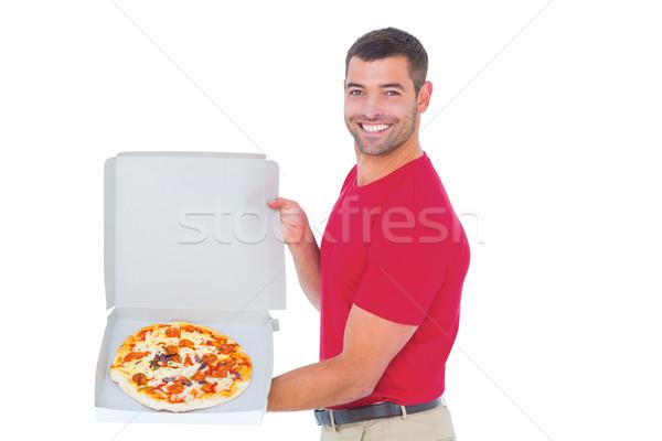 Futár mutat friss pizza fehér portré Stock fotó © wavebreak_media