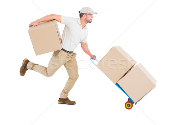 Delivery man with trolley of boxes running Stock photo © wavebreak_media