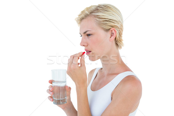 Pretty blonde woman holding glass of water and ready to swallow  Stock photo © wavebreak_media