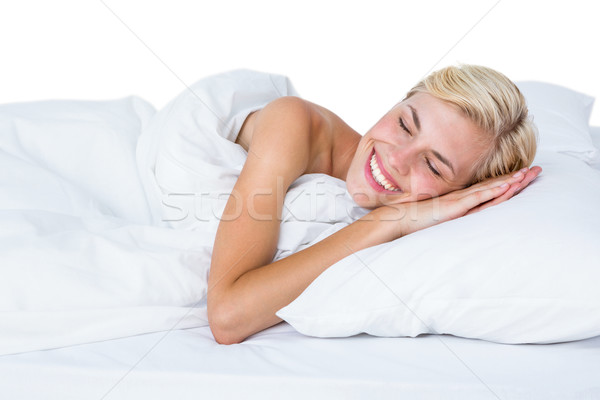 Gülen sarışın kadın yatak beyaz kadın yatak odası Stok fotoğraf © wavebreak_media