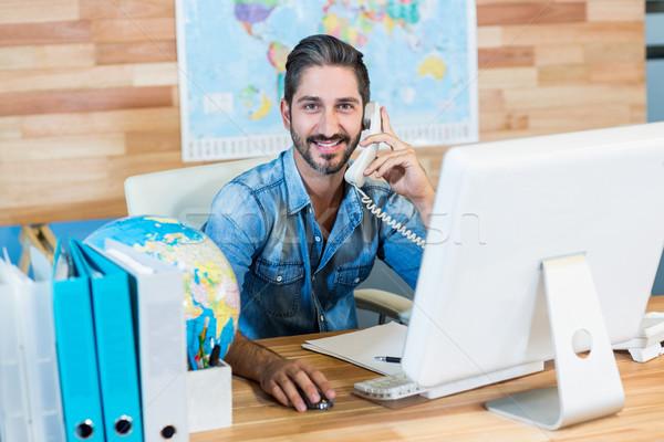 Sorridere viaggio agente ufficio uomo Foto d'archivio © wavebreak_media