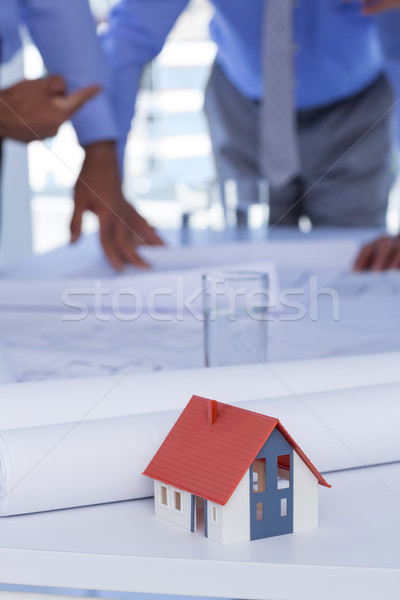 team of business people looking at construction plan  Foto stock © wavebreak_media