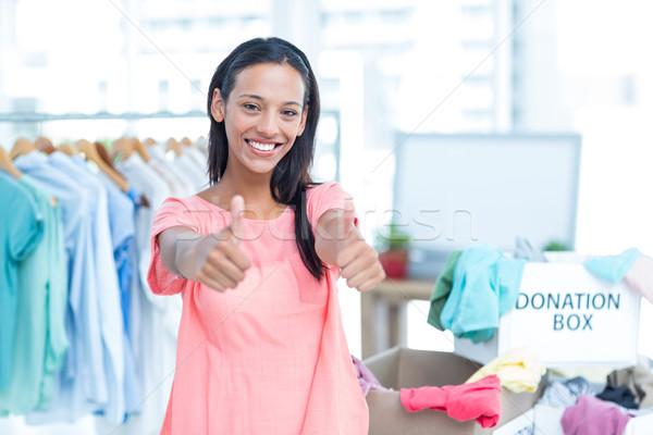 Smiling young female volunteer gesturing thumbs up Stock photo © wavebreak_media