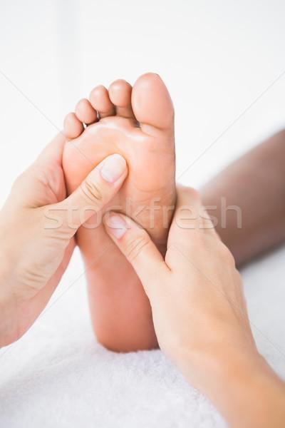 Pretty woman piedi massaggio donna Foto d'archivio © wavebreak_media
