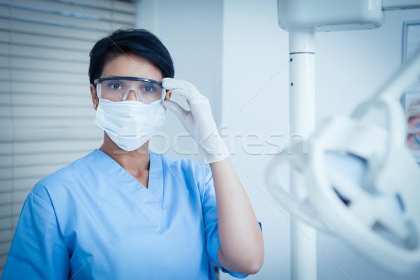歯科 着用 外科手術用マスク 保護眼鏡 肖像 女性 ストックフォト © wavebreak_media