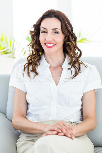 Sonriendo terapeuta mirando cámara blanco mujer Foto stock © wavebreak_media