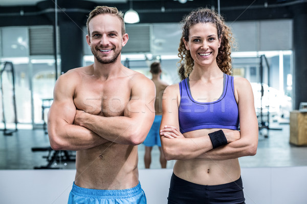 Smiling muscular couple looking at the camera Stock photo © wavebreak_media