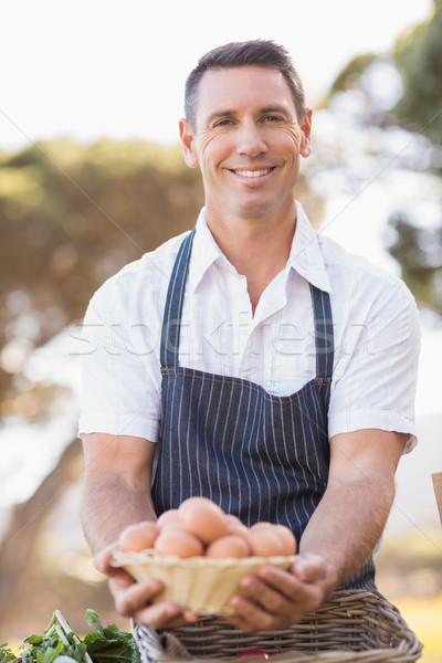улыбаясь фермер корзины яйца портрет Сток-фото © wavebreak_media