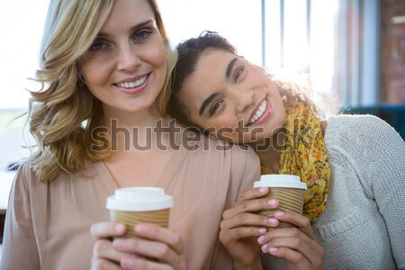 Friends with coffee cups enjoying a conversation at home Stock photo © wavebreak_media
