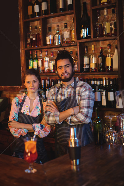 Portrait of waiter and waitress standing with arms crossed at counter Stock photo © wavebreak_media