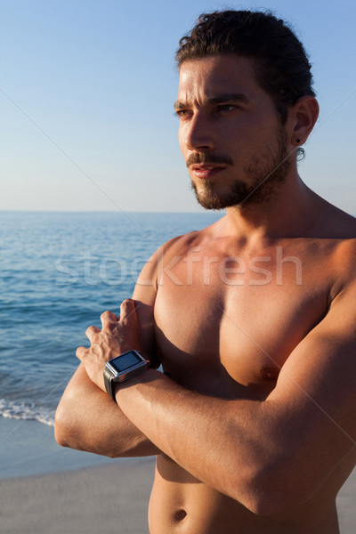 Torse nu musculaire homme permanent plage Photo stock © wavebreak_media