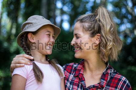Close up of playful couple standing against trees Stock photo © wavebreak_media