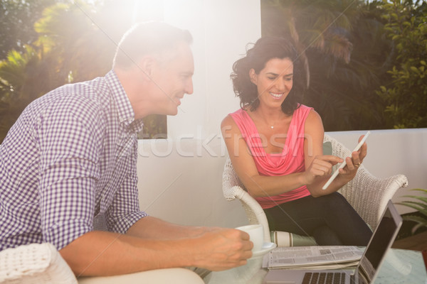 Woman with man discussing over digital tablet Stock photo © wavebreak_media