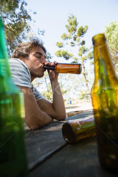 Man drinking beer from bottle in the park Stock photo © wavebreak_media