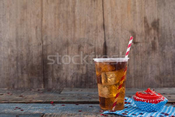 Díszített minitorta hideg ital negyedike fa asztal kék Stock fotó © wavebreak_media