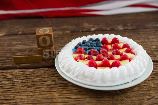 Date blocks and fruitcake on wooden table with 4th july theme Stock photo © wavebreak_media