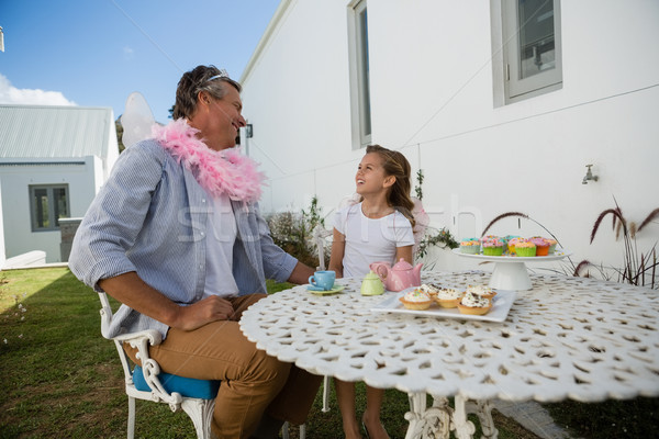 Father and daughter in fairy costume having fun Stock photo © wavebreak_media