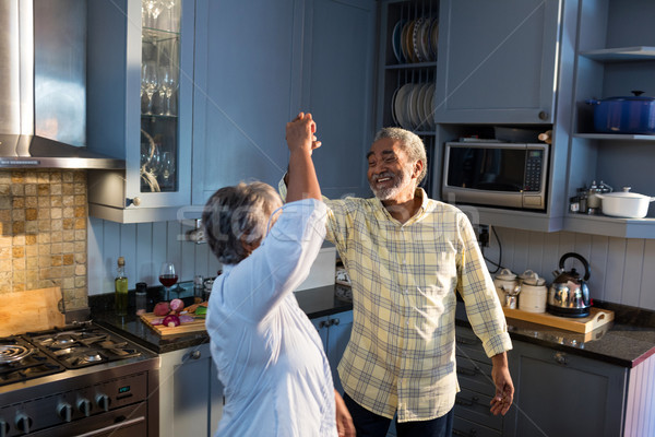 Smiling couple dancing in kitchen at home Stock photo © wavebreak_media