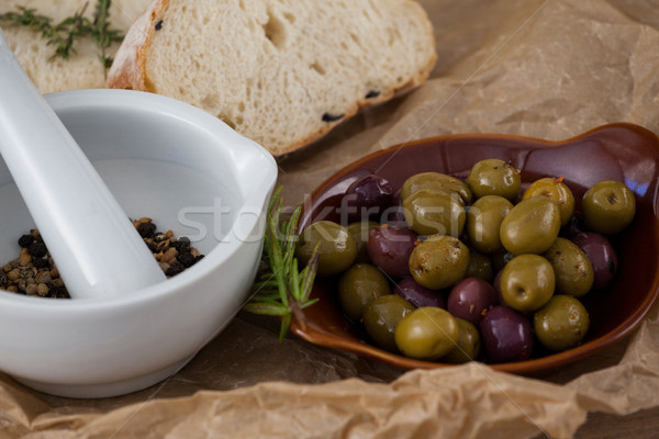 Stock photo: Close up of olives by spices in mortar pestle