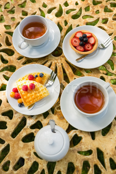 Cup of tea with dessert on table Stock photo © wavebreak_media