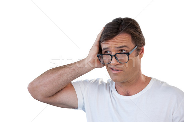 Confused mature man wearing eyeglasses looking away Stock photo © wavebreak_media